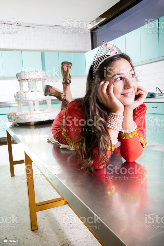 Young Woman Wearing Crown Posing with Birthday Cake royalty-free stock photo