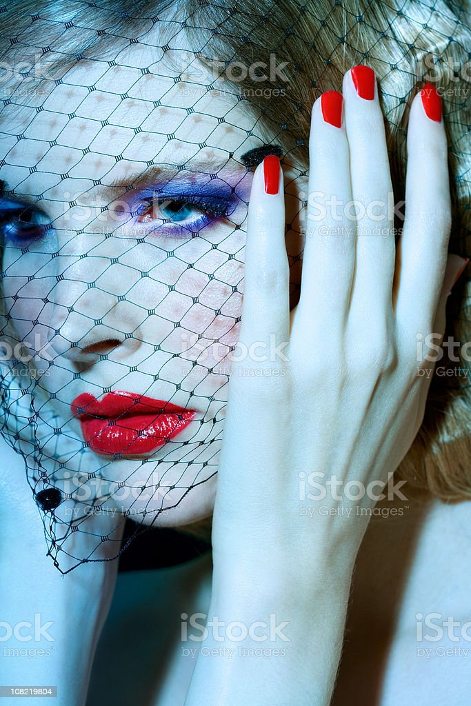 Young Woman Wearing Fishnet Face royalty-free stock photo