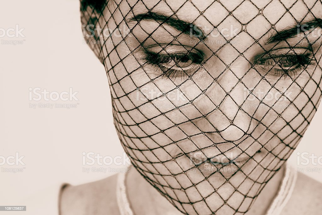 Young Woman Wearing Fishnet Mask stock photo