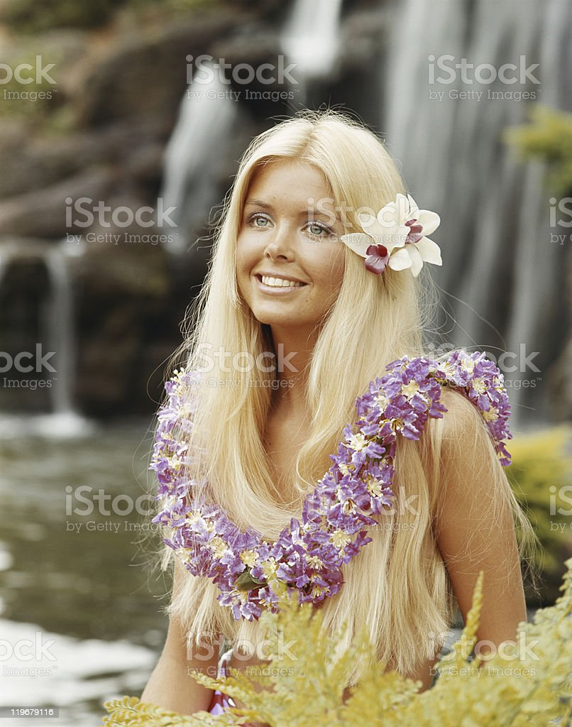 Young woman wearing flowers and garland, smiling royalty-free stock photo