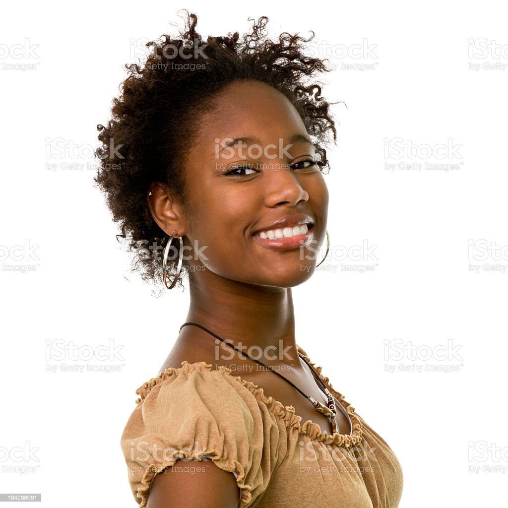 Young woman wearing gold hooped earrings is smiling stock photo