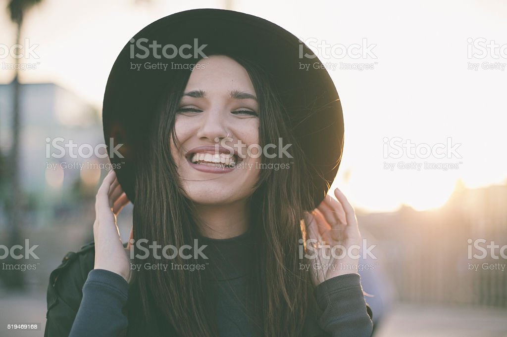 Young woman wearing hat stock photo