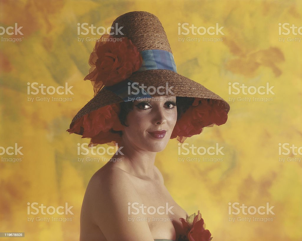 Young woman wearing hat, smiling, portrait, close up stock photo