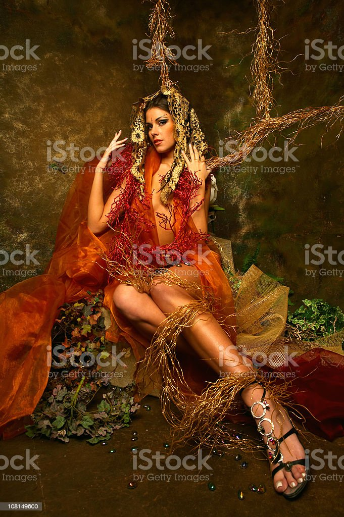 Young Woman Wearing Head Veil Posing with Nature Props royalty-free stock photo
