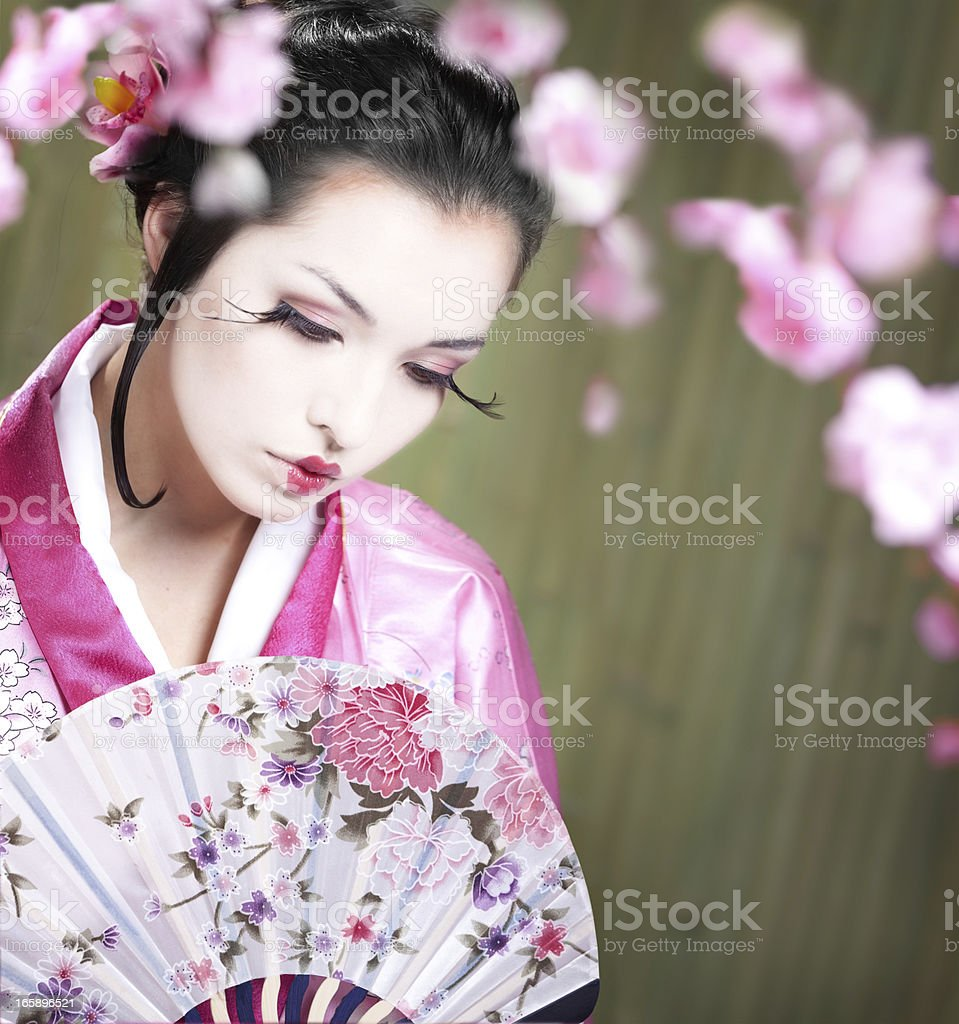 Young  Woman Wearing Kimono Dress at the Bamboo Backgruond royalty-free stock photo