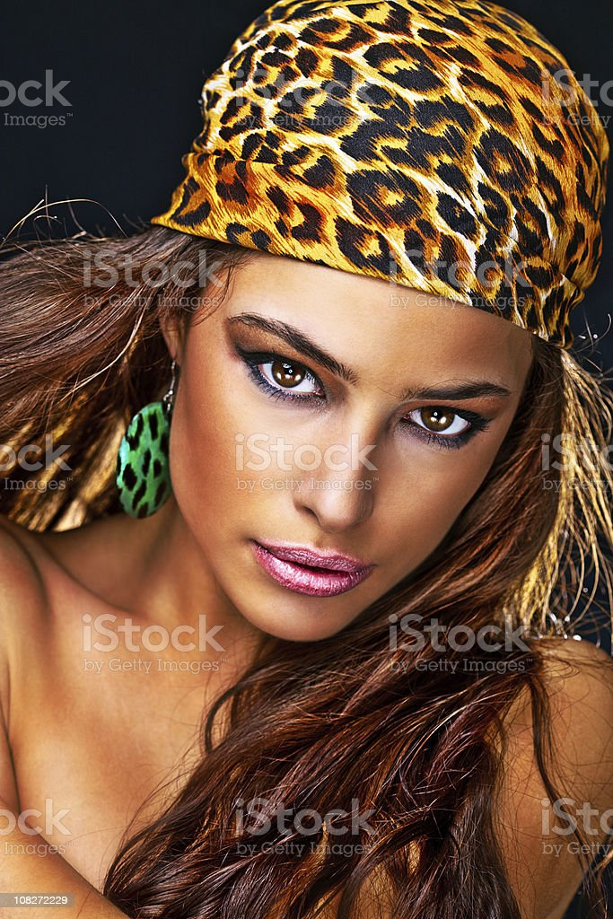 Young Woman Wearing Leopard Print Scarf on Head royalty-free stock photo