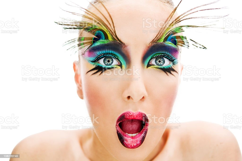 Young Woman Wearing Make-Up and Peacock Feathers on Eyebrows royalty-free stock photo