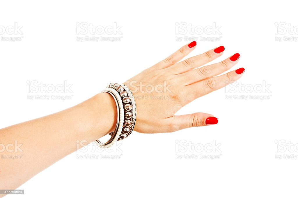 Young woman wearing many silver bangles stock photo