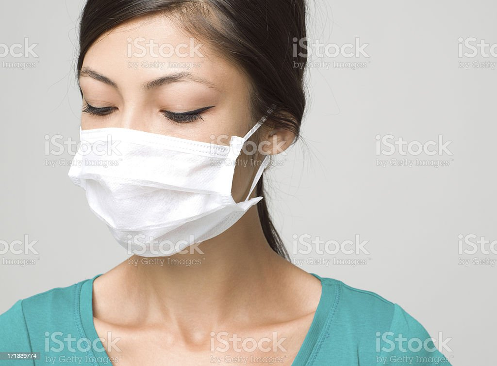Young Woman Wearing Medical Face Mask royalty-free stock photo