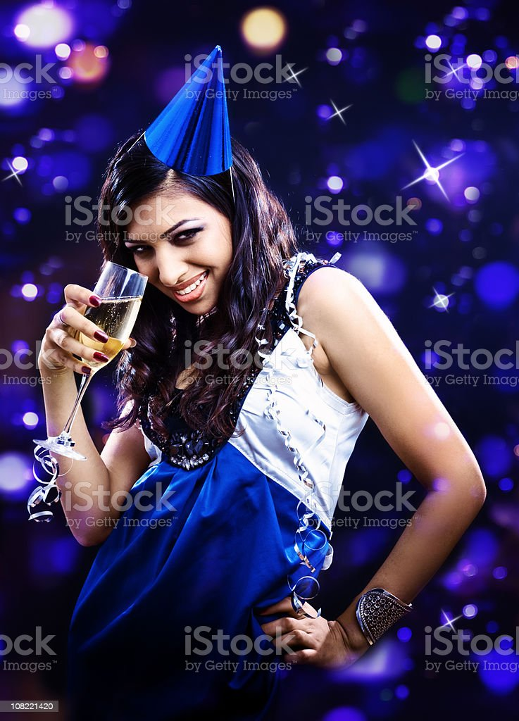 Young Woman Wearing Party Hat drinking Champagne royalty-free stock photo