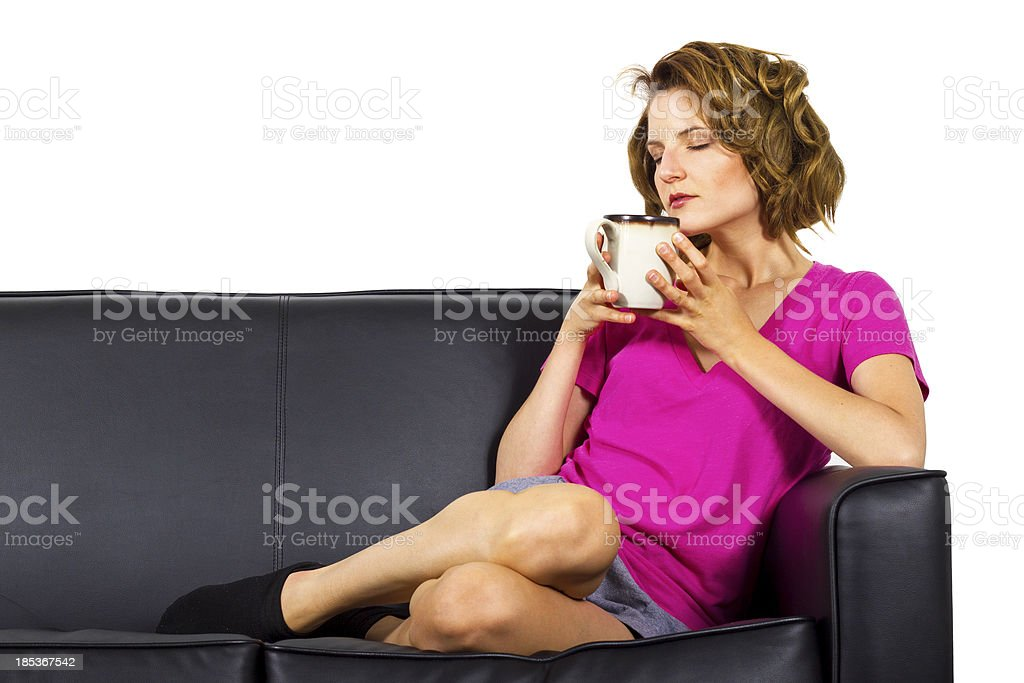Young woman wearing pink drinking coffee royalty-free stock photo