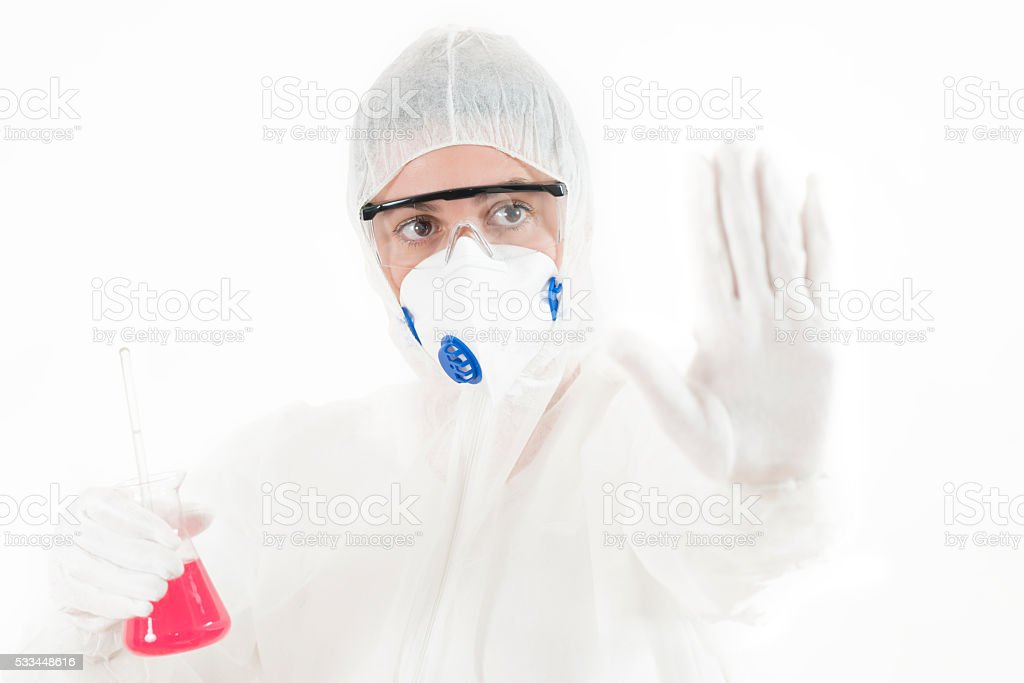 Young Woman wearing protective suit holding some laboratory glassware stock photo