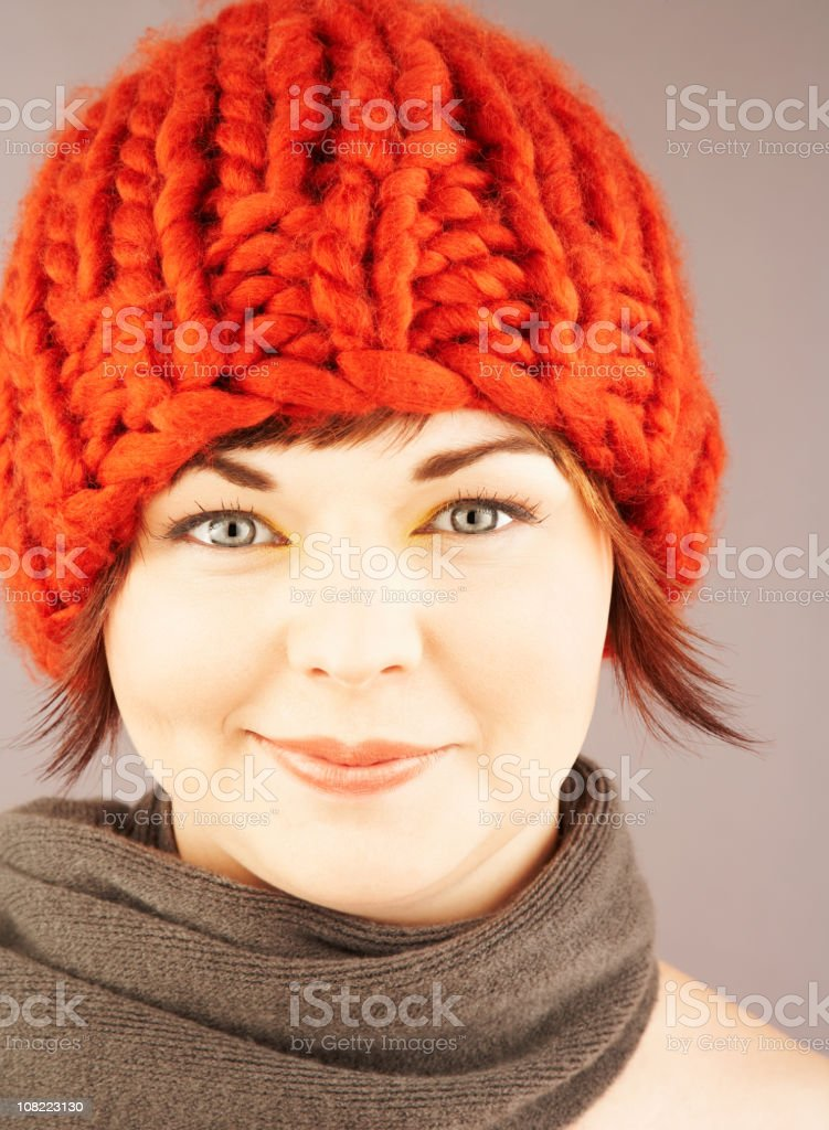Young Woman Wearing Scarf and Winter Hat royalty-free stock photo
