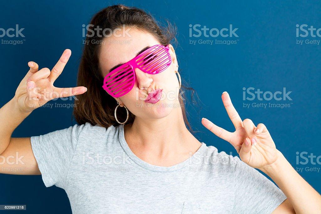 Young woman wearing shutter shades sunglasses stock photo