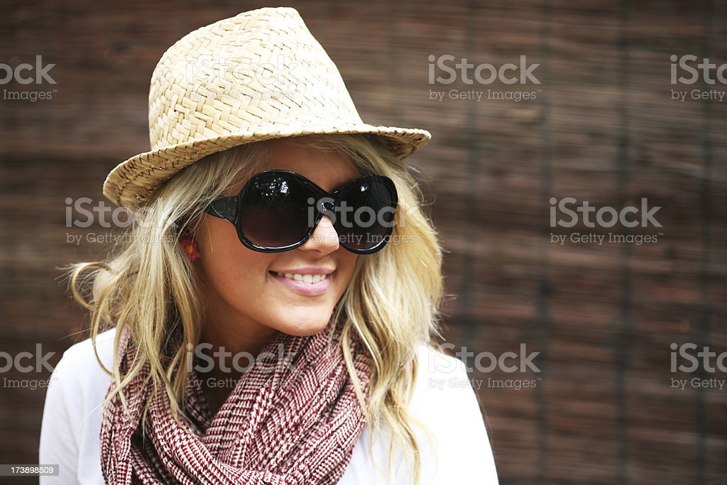 Young woman wearing straw hat and large sunglasses royalty-free stock photo