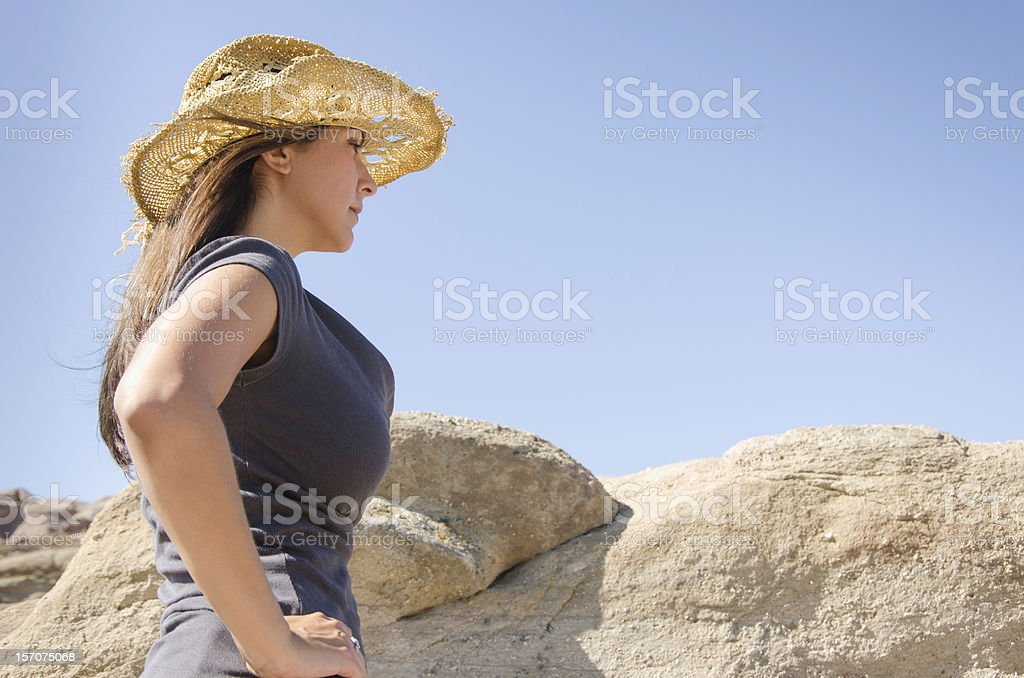 Young Woman wearing straw hat stock photo