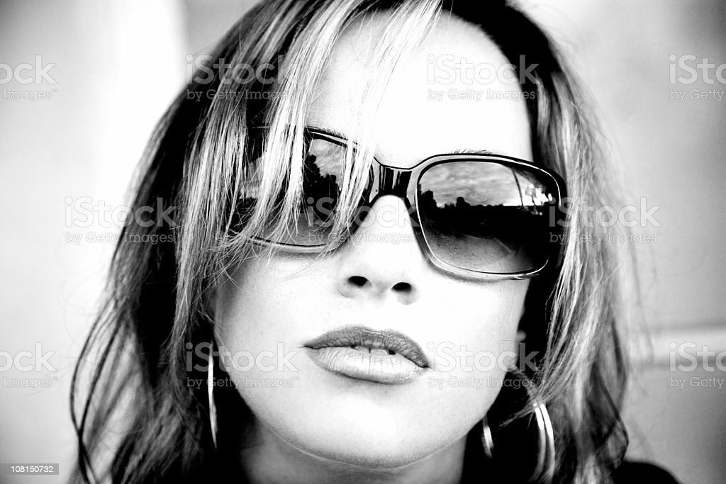 Young Woman Wearing Sunglasses, Black and White royalty-free stock photo