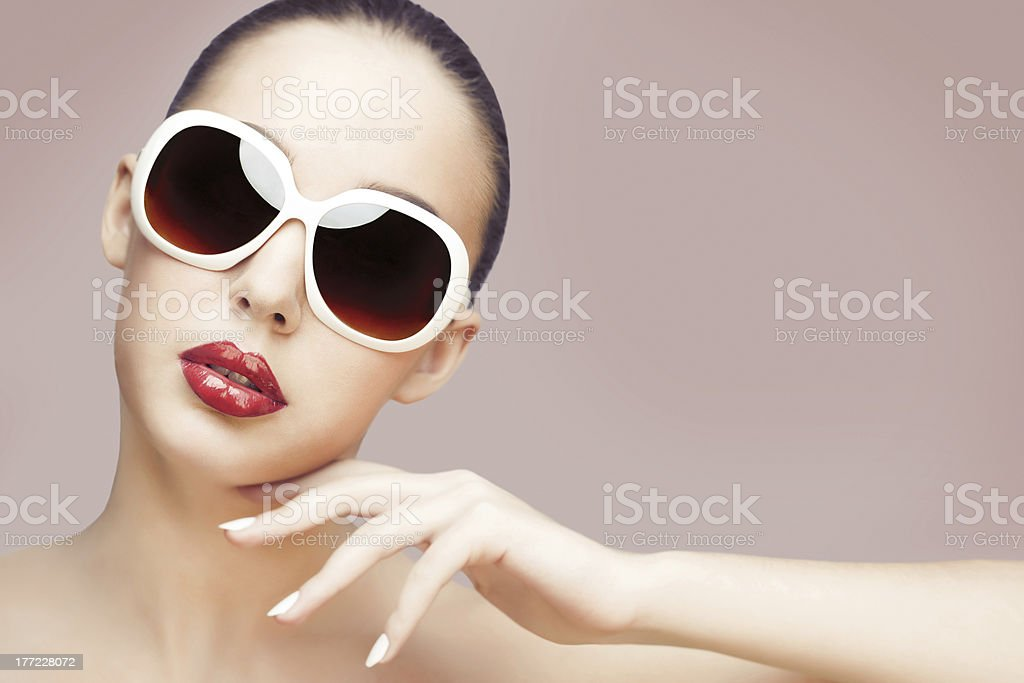 young woman wearing sunglasses royalty-free stock photo