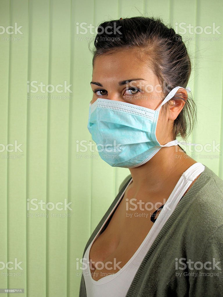 Young woman wearing surgical mask stock photo