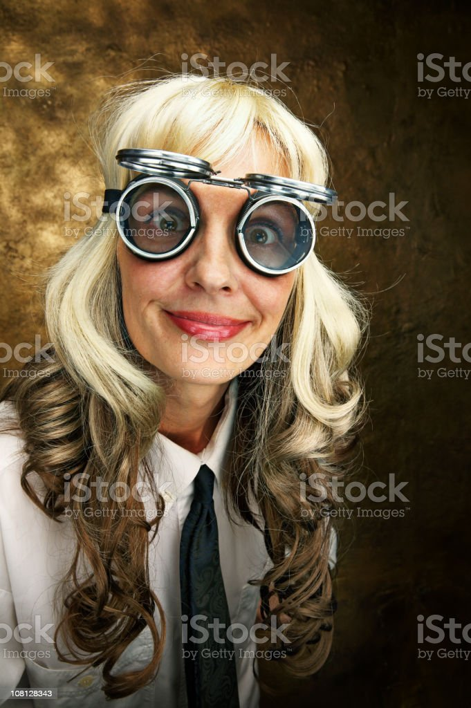 Young Woman Wearing Tie and Crazy Goggles royalty-free stock photo