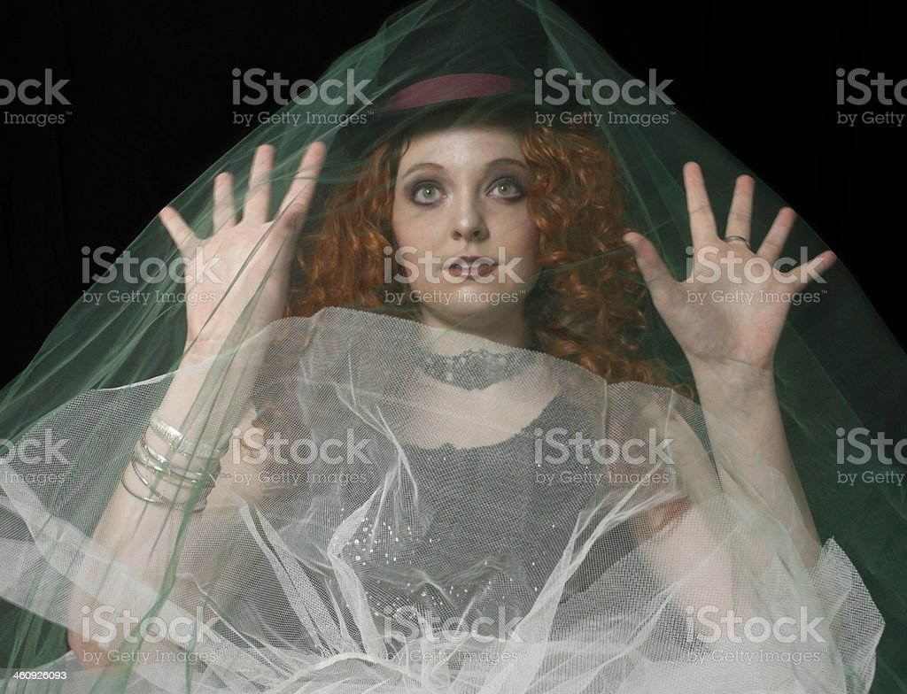 Young woman wearing top hat with green veil. stock photo