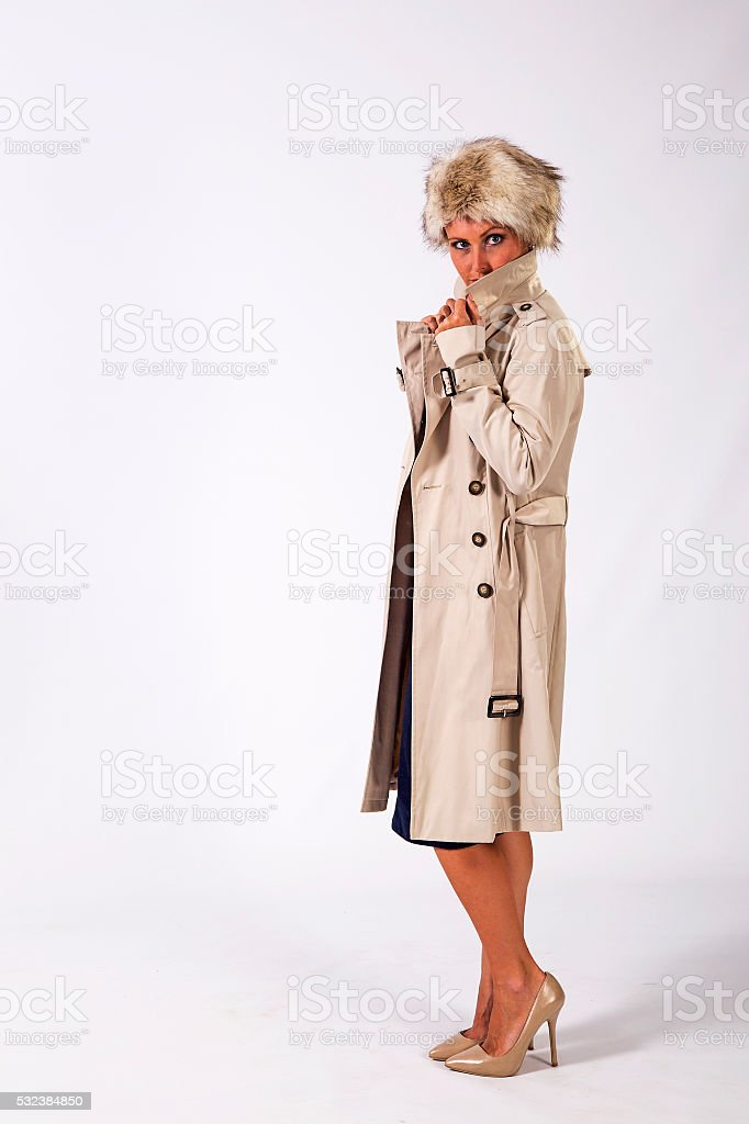 Young Woman wearing trench coat stock photo