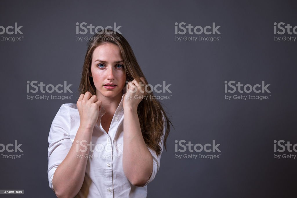 Young Woman Wearing White Button-up Shirt stock photo