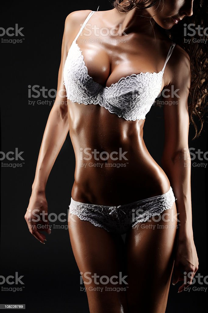 Young Woman Wearing White Lingerie, Low Key royalty-free stock photo