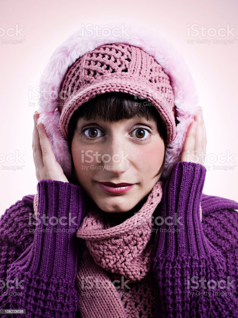 Young Woman Wearing Winter Hat and Earmuffs royalty-free stock photo