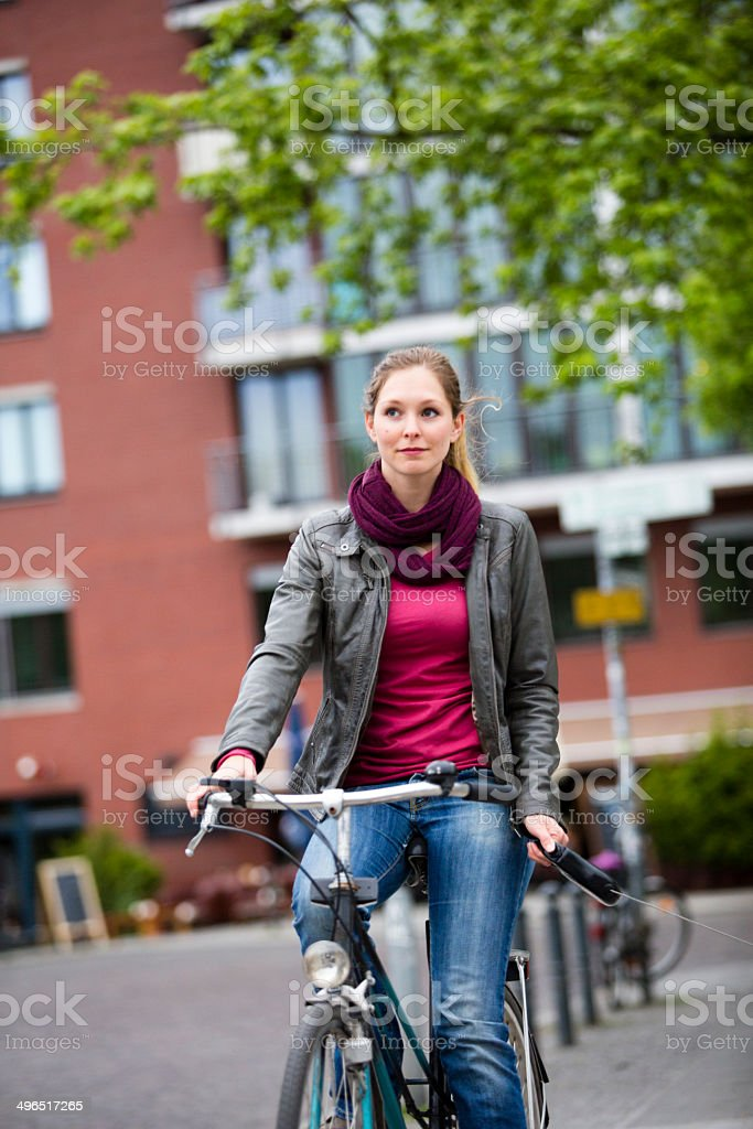 Young woman while cycling royalty-free stock photo