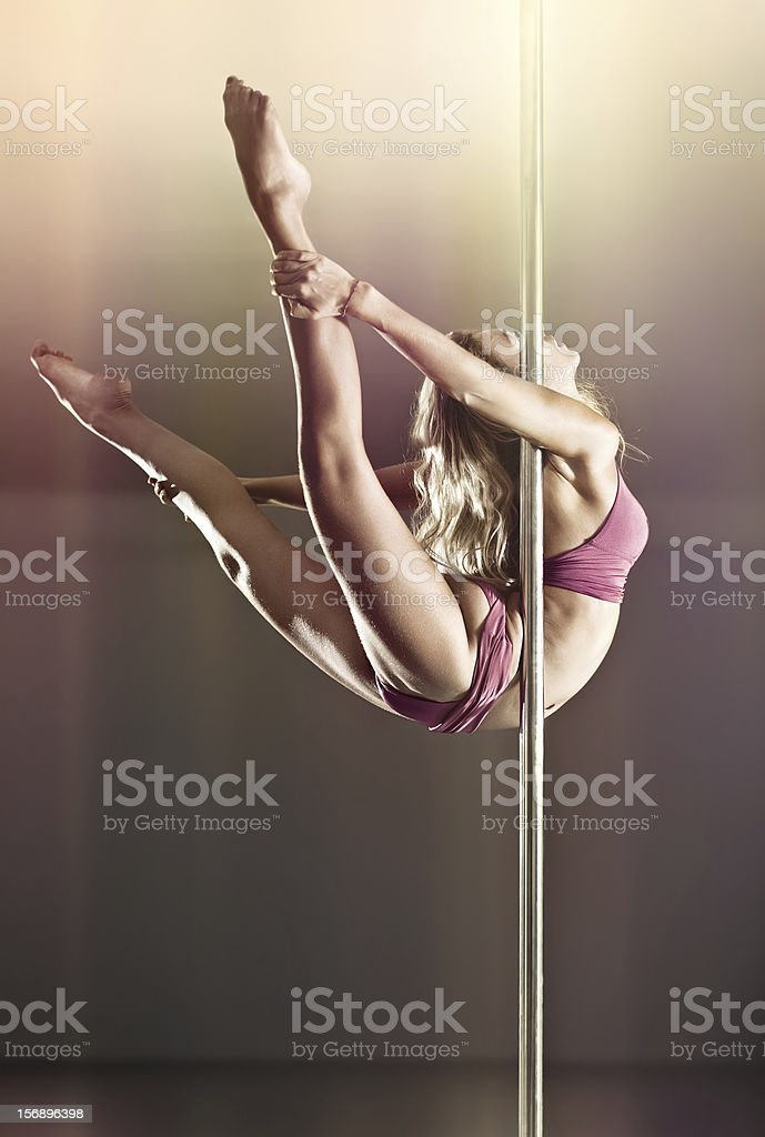 A young woman who is dancing on a pole stock photo