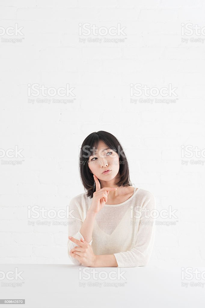 Young woman who thinks about something stock photo
