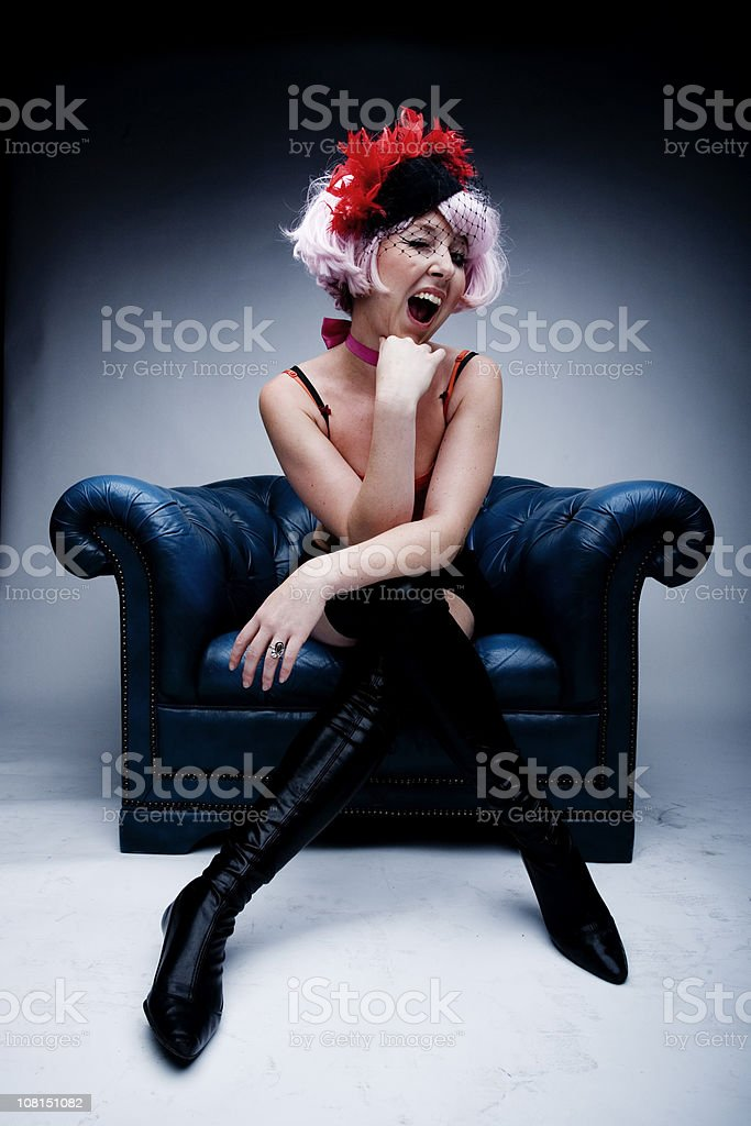 Young Woman Winking and Posing in Cabaret Clothing royalty-free stock photo