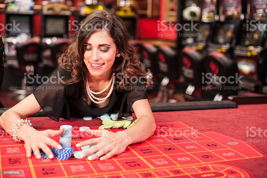 Young Woman Winning at American Roulette Game stock photo