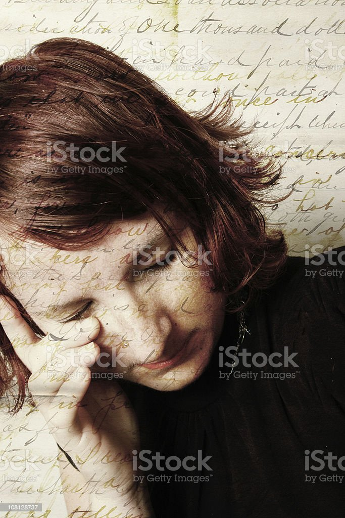 Young Woman Wiping Tears with Overlayed Writing royalty-free stock photo