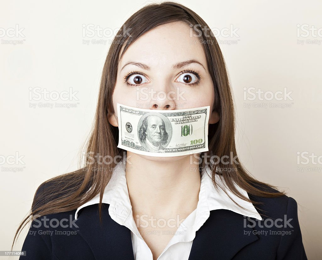 Young woman with 100 dollars on her mouth royalty-free stock photo