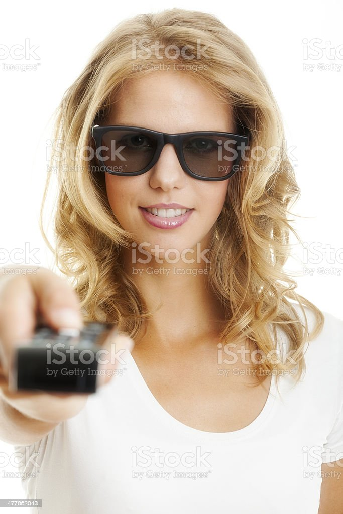 Young woman with 3d glasses and remote control royalty-free stock photo