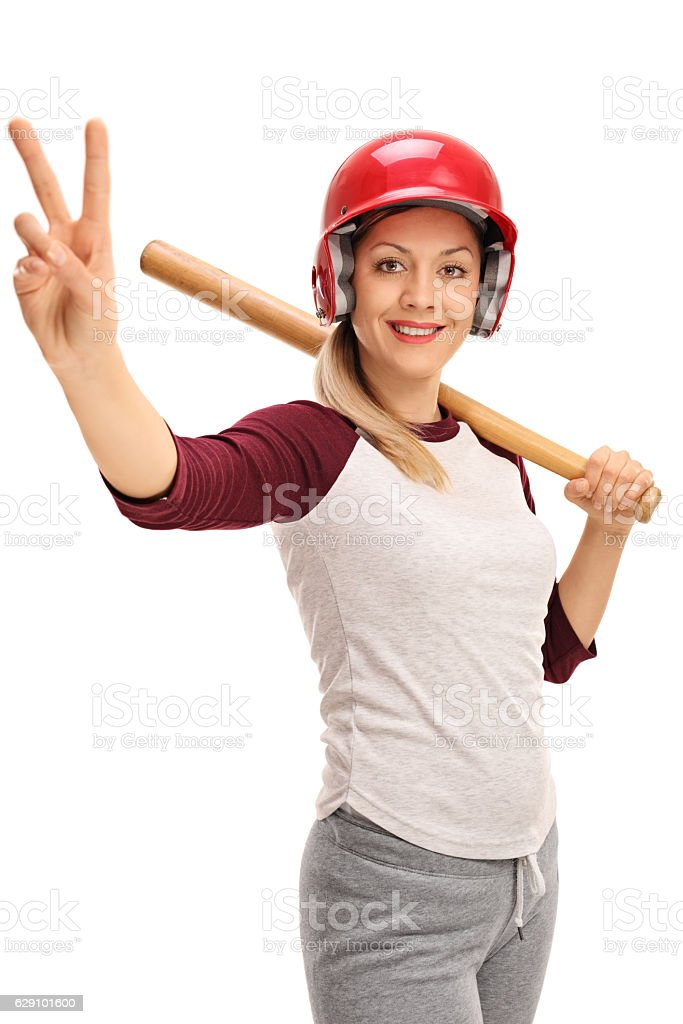 Young woman with a baseball bat and a helmet stock photo