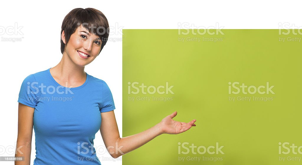 Young woman with a blank sign royalty-free stock photo