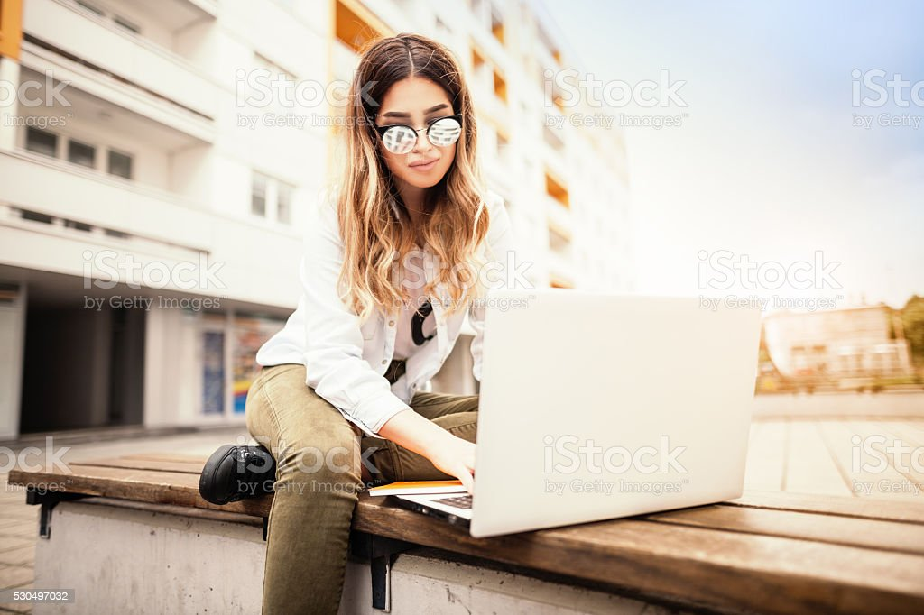 Young woman with a book and coffee stock photo