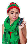 Young woman with a broken smartphone on christmas