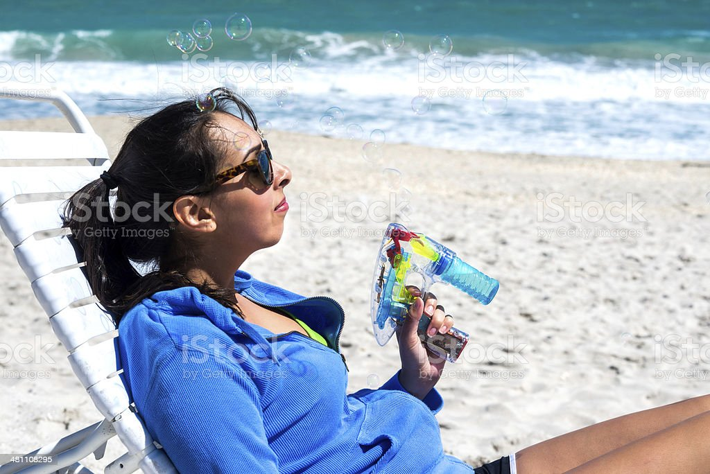 Young Woman With a Bubble Gun at Vero Beach stock photo