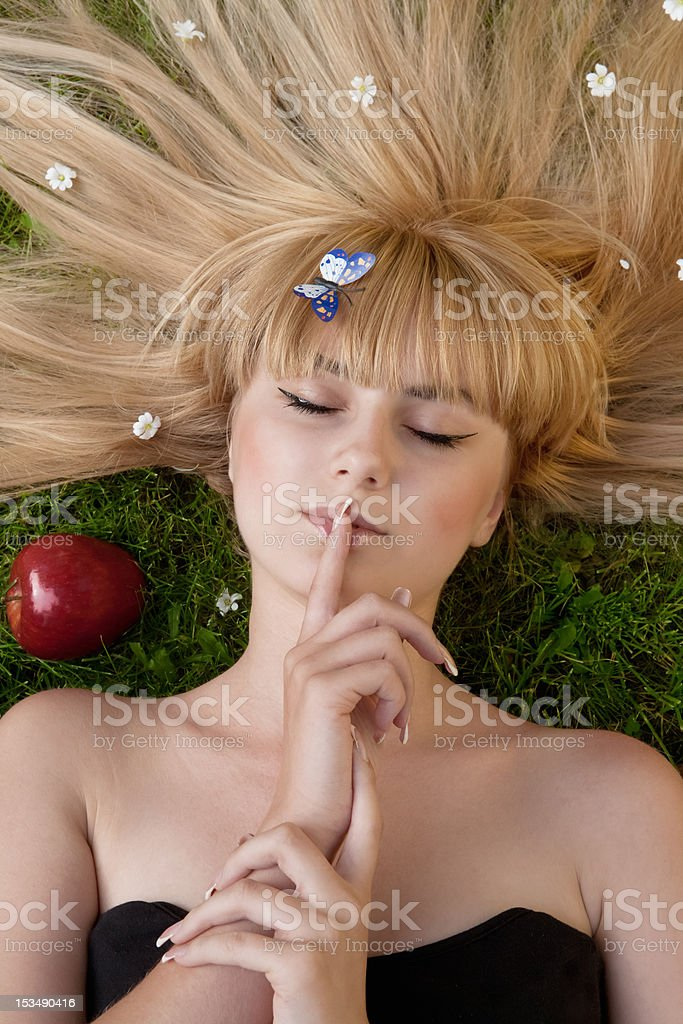 Young woman with a butterfly royalty-free stock photo