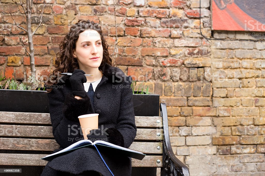 young woman with a coffee and textbook royalty-free stock photo