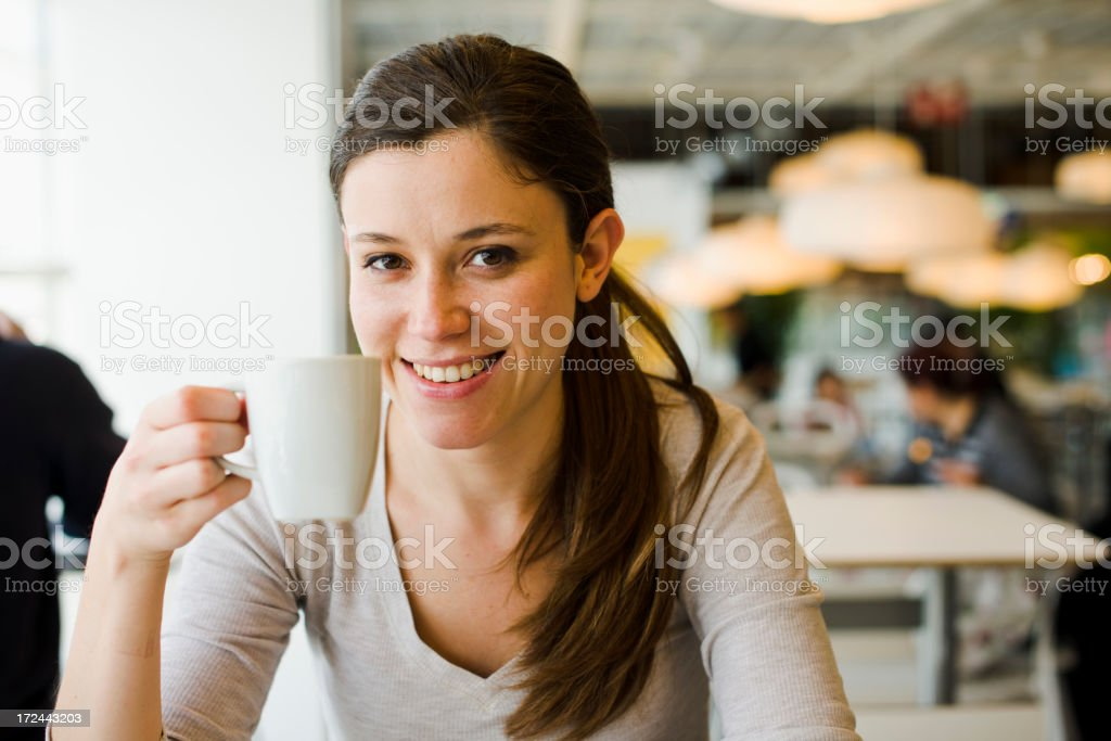 Young woman With a Coffee Cup royalty-free stock photo