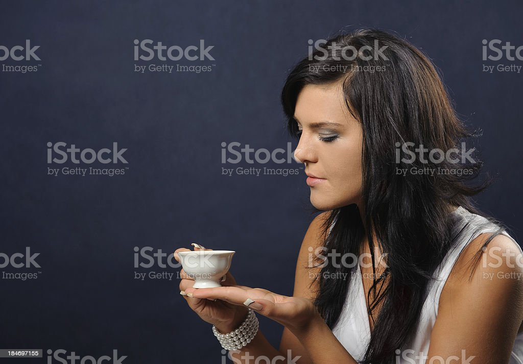 Young woman with a cup of tea royalty-free stock photo