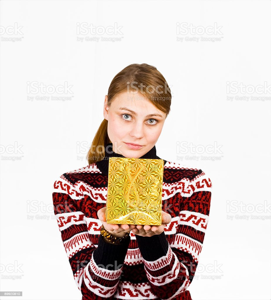 young woman with a gift bag in her hands royalty-free stock photo