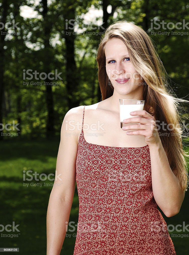 young woman with a glass of milk in outdoors royalty-free stock photo