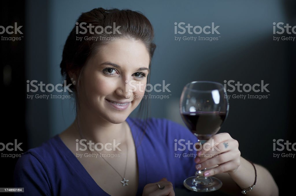 Young Woman with a Glass of Wine royalty-free stock photo
