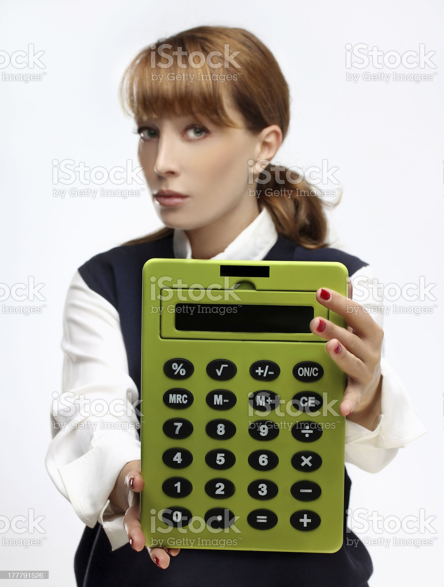 Young   woman with a green  big calculator in her hands royalty-free stock photo
